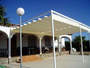 Sistemas de toldos para patio o jard n en alicante for Modelos toldos para patios